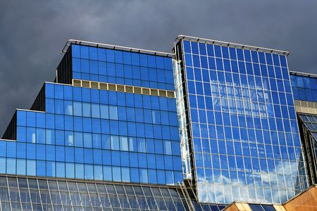 Business building with blue glass and reflections photo