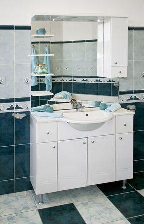 Big bathroom dresser with deep blue ceramics photo