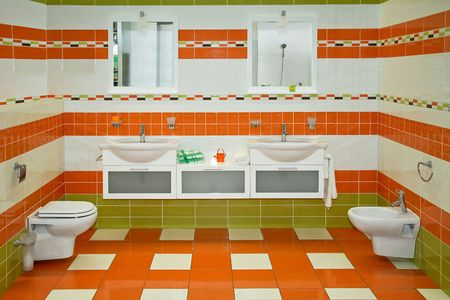 Big bathroom with orange and green ceramics photo