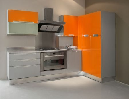 New modern kitchen in orange with metal  Stock Photo - 2085537