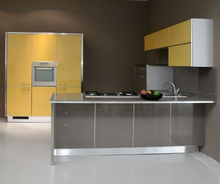 New modern kitchen in yellow with metal Stock Photo - 2085536
