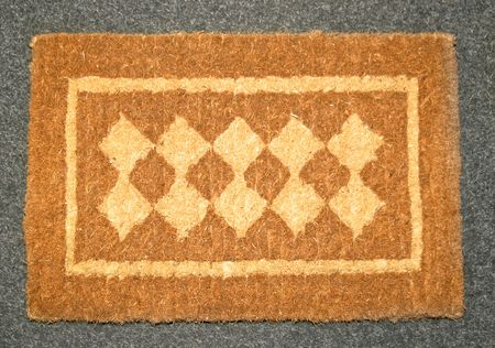 classics: Classics brown doormat made from natural material  Stock Photo
