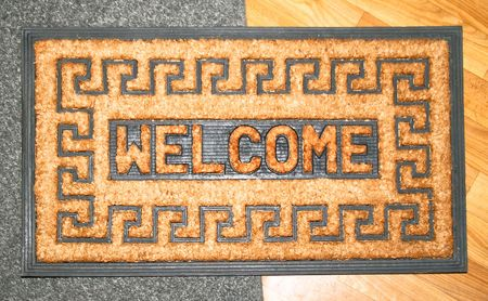 front stoop: Doormat made from natural material with welcome sing Stock Photo