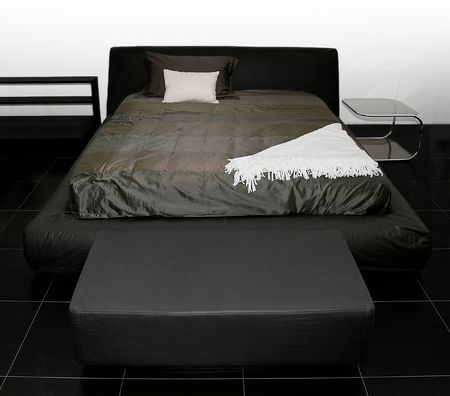 Bedroom with big double bed in black Stock Photo - 2096240