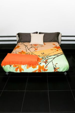Bedroom with big double bed and colorful sheets Stock Photo - 2096238