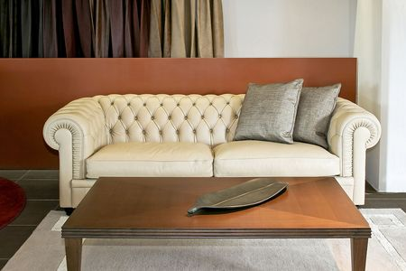 classics: Classics luxury sofa with pillows and table Stock Photo