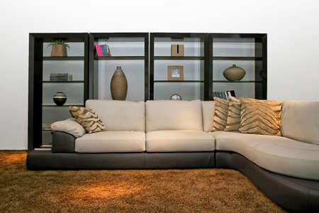 Big and modern sofa with wooden shelf Stock Photo - 2105558