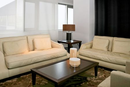 Bright and modern living room with leather sofas Stock Photo - 2105557