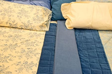 Blue and beige bedding sheets and pillows Stock Photo - 2221464
