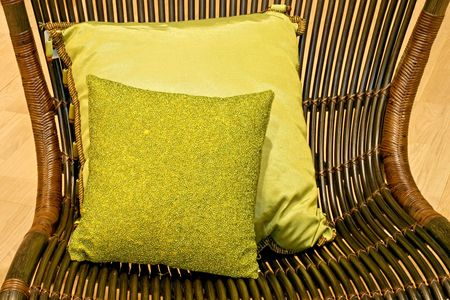 Two green pillows on the arm chair Stock Photo - 2221482