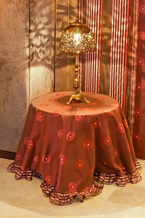 Vintage look lamp on the round table Stock Photo - 2366139