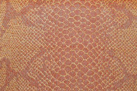 orange snake: Real snake skin leather pattern textured background