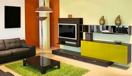 Modern living room with green and terracotta colors Stock Photo - 2391172