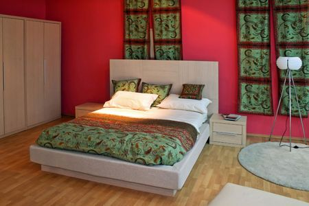 Oriental bedroom with red walls and green curtains Stock Photo - 2409269