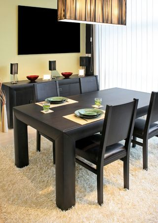 Modern dinning room with black table and closet photo