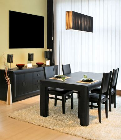 Modern dinning room with black table and closet