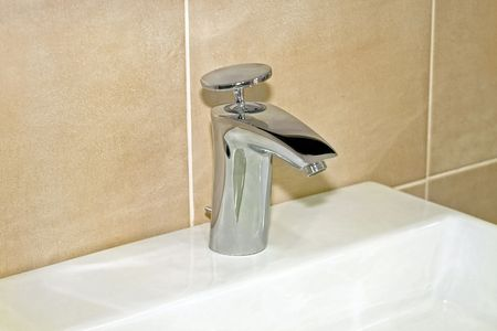 lavabo: Just simple lavabo faucet in new bathroom Stock Photo