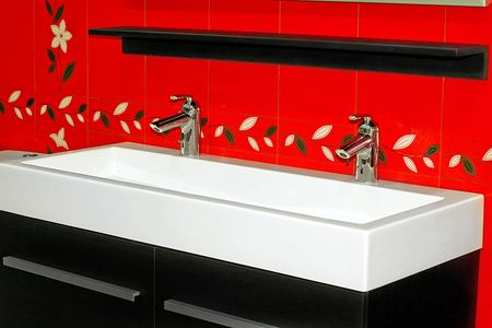 Double lavabo in new modern red bathroom