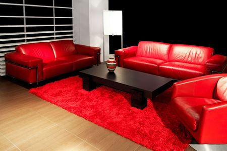 Red living room with two leather sofas