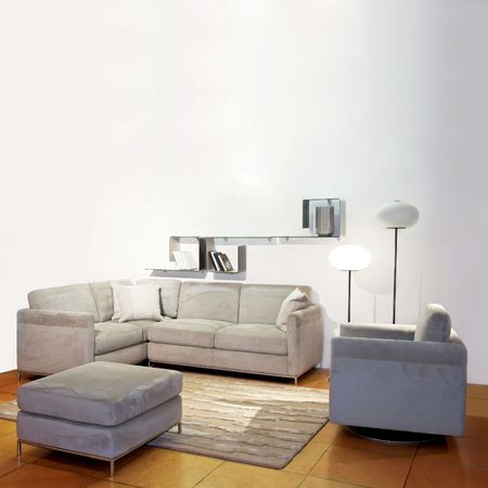 grey rug: Simple living room with gray seat and lamps