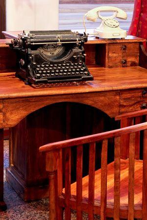 Vintage typewriter and white telephone on the desk Stock Photo - 2730058