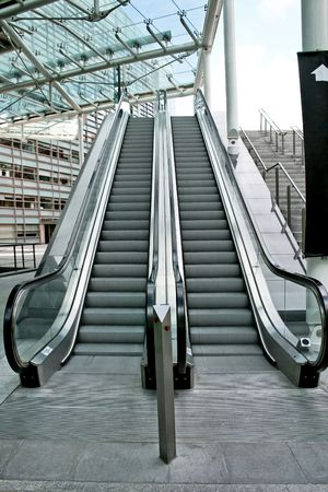 Two parallel automatic escalators in business building photo