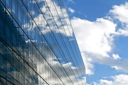 vanishing: Vanishing building with sky reflections and cloudscape Stock Photo
