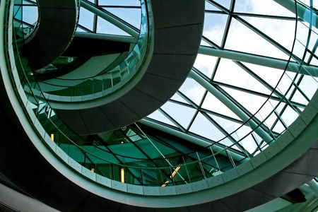 Big spiral stairway and windows from above photo