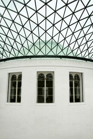 Three big windows on oval marble building photo