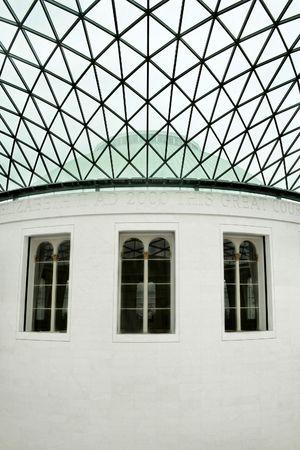 Three big windows on oval marble building photo