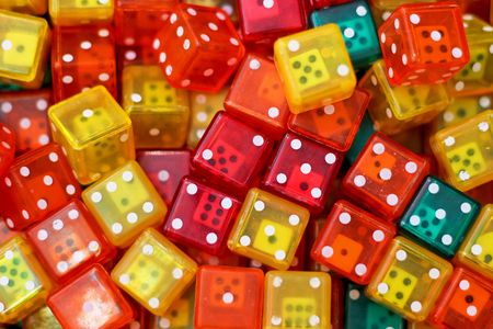 Bunch of colorful dices made from plastic