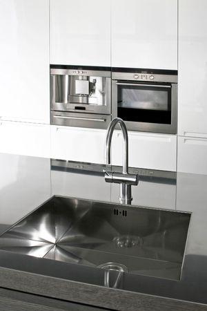 Interior of modern kitchen with counter sink photo