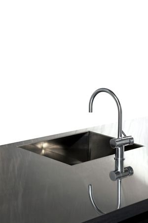 Close up shot of faucet and reflection in counter Stock Photo