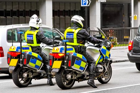 Two police officers on motorbikes at London streets photo