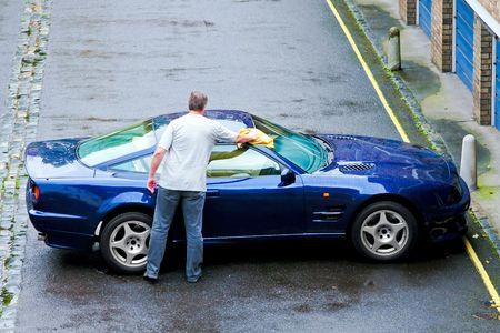 Washing and polishing own luxurious sports car photo