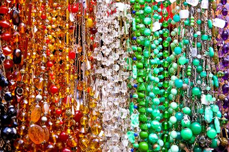 Long row of colorful fashionable bead necklaces photo