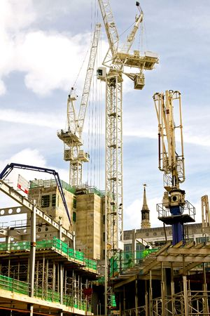 heavy machinery: Construction site with cranes and heavy machinery