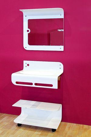 Modern designed bathroom vanities with pink wall photo