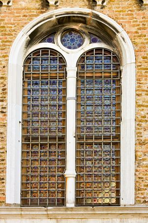 decayed: Old decayed church window with metal grid