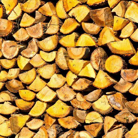 Big pile of firewood neatly aligned together  photo