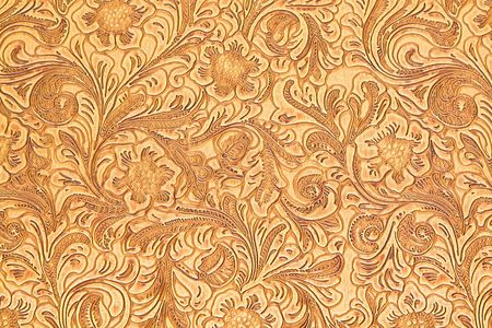 Texture of wooden carved floral ornamental board photo