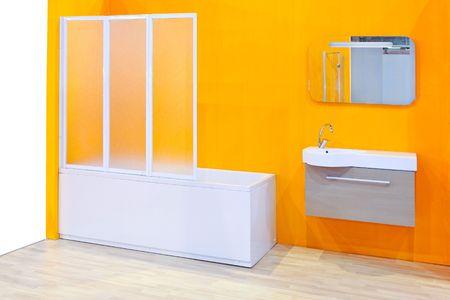 Modern bathroom vanities in a yellow bathroom  photo