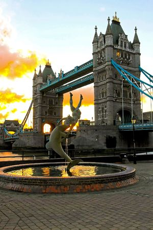 Fountain sculpture in front of London Tower bridge photo