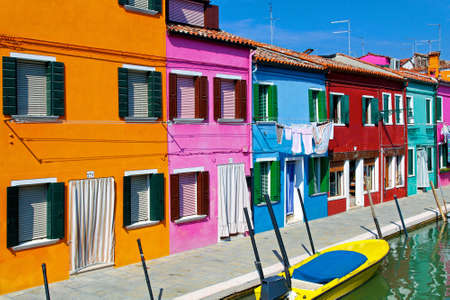 mediterranean houses: Colorful buildings in Burano island street canal