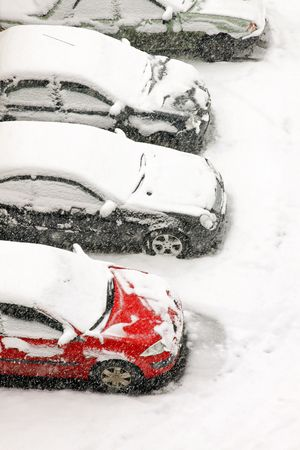 snowed: Cars parked under heavy snow during blizzard