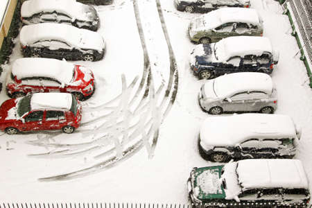 a lot of: Car tracks in parking lot during snowstorm Stock Photo
