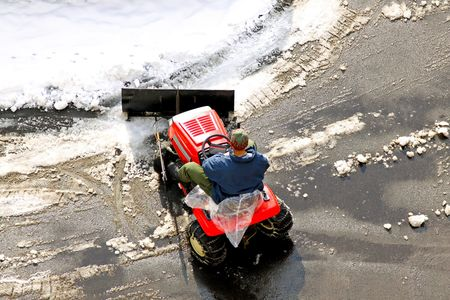 Man cleaning the road covered in snow photo