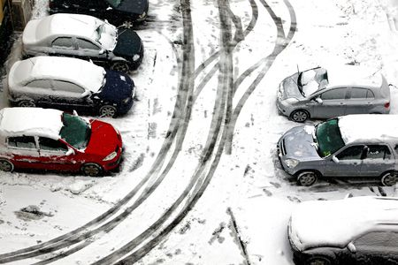 Snowed in cars parked in a parking lot photo
