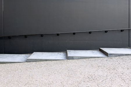 hand rail: Gray concrete stairs with metal hand rail