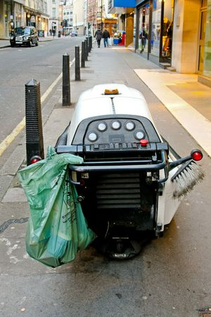 Modern automatic cleaning machine for street pavements photo